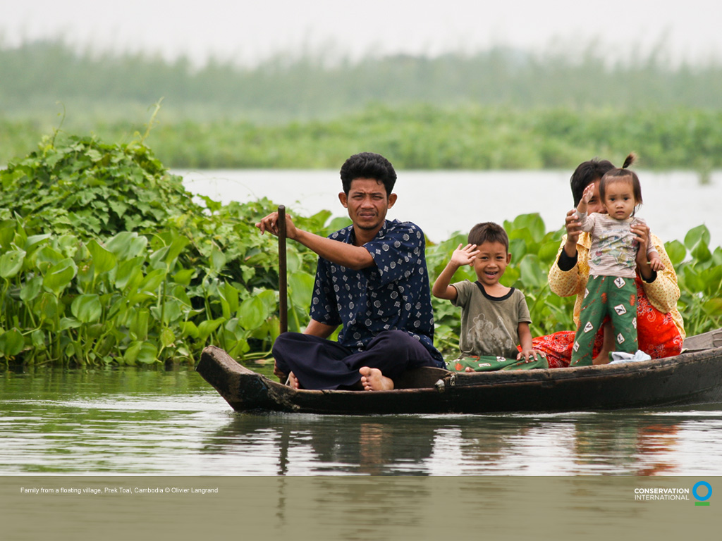 A family from a floating village, Prek Toal, on Tonle Sap lake in Cambodia.