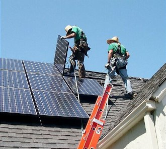 Installing solar panels in Colorado.  Part of a nutritious green economic development policy breakfast.  Good job, guys.